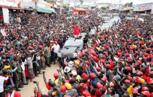 President Uhuru Kenyatta waves to the crowd during their Jubilee campaign in West Pokot County