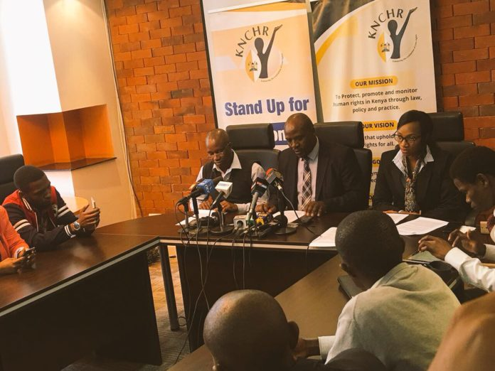 KNCHR Vice Chairperson George Morara (centre) addressing the press