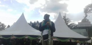 Likuyani MP Dr. Enoch Kibunguchy addressing residents during the launch of the program