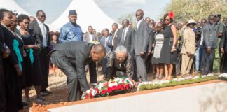 President Uhuru Kenyatta and First Lady Margaret Kenyatta laying a wreath at the grave of the late Joseph Nkaissery