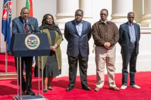 President Uhuru Kenyatta addressing the press at State House after the demise of the late Nkaissery, flanked by other Cabinet Secretaries including Interior acting CS and Education CS Fred Matiang'i