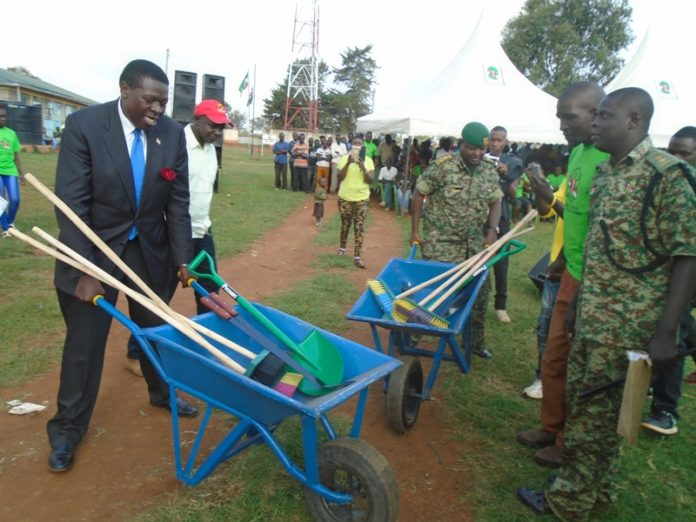 Water and Irrigation Cabinet Secretary Eugene Wamalwa and NYS deputy director Mr. James Tembur pushing wheelbarrows during the launch of NYS program in Likuyani