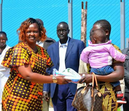 West Pokot County first lady Josephine Kachapin handing over a mosquito net