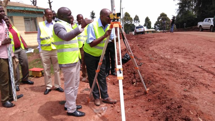 KURA (Kenya Urban Roads Authority) officers inspecting the road