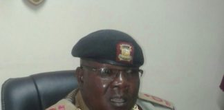 Administration police commandant Charles Aketch talking to journalists at his office