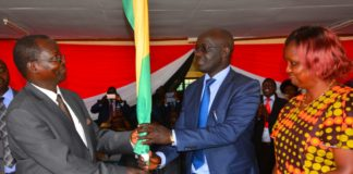 Simon Kachapin handing over the reins to West Pokot Governor John Lonyangapuo