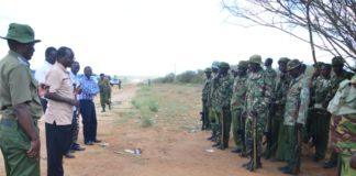 West Pokot Governor John Lonyangapuo getting a brief from security team at Turkwel