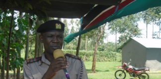 Matete sub county Deputy County Commissioner George Omollo addressing a security baraza