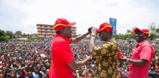 President Uhuru Kenyatta and Deputy President William Ruto receiving Paul Otuoma to Jubilee, during their campaign in Busia