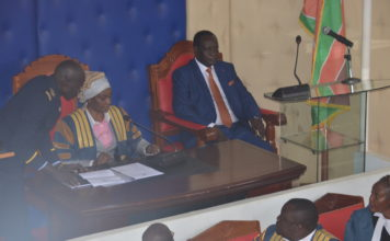 Vihiga Governor Dr. Wilber Otichilo (right) at the County Assembly Chambers before addressing the assembly
