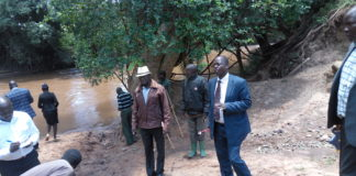 West Pokot Governor John Lonyangapuo at river Suam with KeRRA engineers
