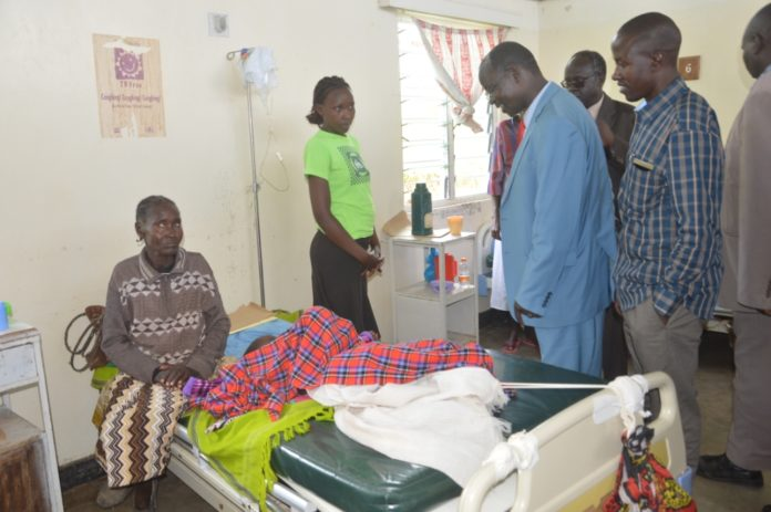 West Pokot Governor John Lonyangapuo in a ward at Kapenguria hospital