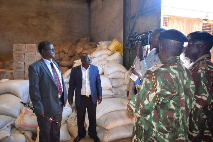 West Pokot Governor John Lonyangapuo (left) condemned the alleged relief food theft in the County