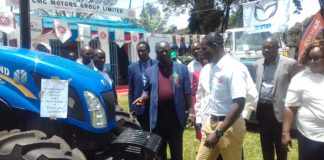 Trans Nzoia Governor Patrick Khaemba (centre) at the ASK agriculture show in Kitale
