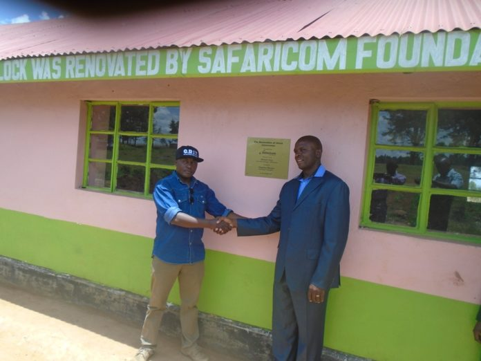 The Safaricom Foundation sales manager Rift region Mr. Michael Thuo (R) with the project champion Mr. Magellan Mungui Otanga