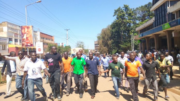 Former Kakamega Senator Bonny Khalwale leading supporters during demonstrations in Kakamega