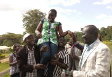 Vivian Kapelion celebrates her KCPE performance with parents at home lityei
