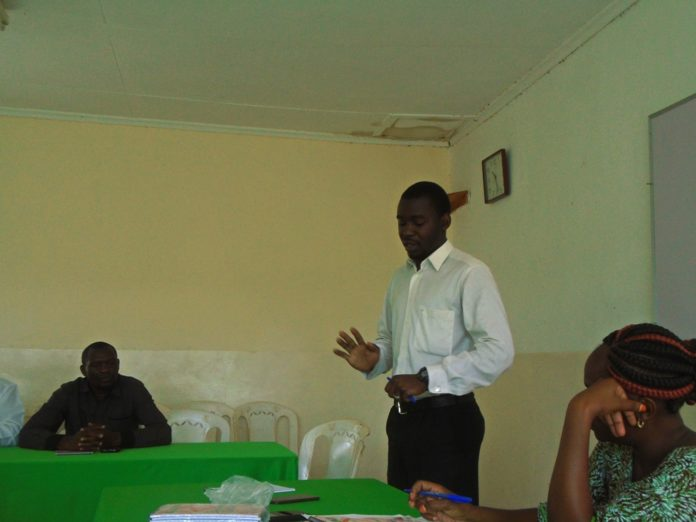 Lugari MOH Dr. Isaiah Walela addressing participants during a stakeholders meeting held at Homelady Guest House