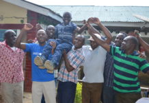 Philip Mwangale celebrating the good KCPE results together with his teachers at the school