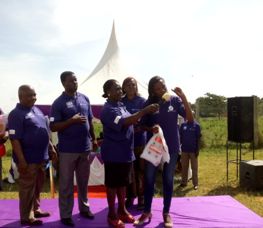 Bungoma County First Lady Caroline Wangamati giving out baby carriers