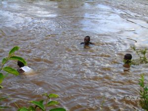 Local divers searching for the body of the 11 year old boy who drowned in River Nzoia