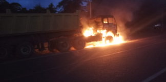 The truck which was set ablaze after the accident