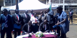 Nandi County Governor Stephen Sang signing the MoU earlier
