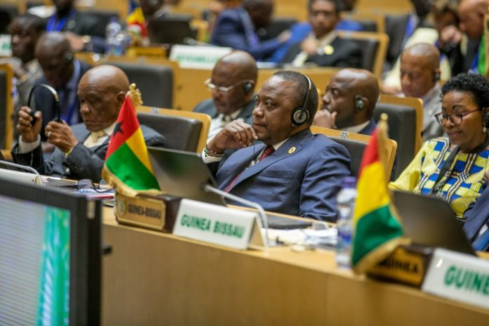 President Uhuru Kenyatta (centre) at the AU summit in Ethiopia