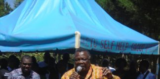 COTU Secretary General Francis Atwoli addressing mourners during the burial of Human Rights Activist Ken Wafula at Seregeya village in Likuyani