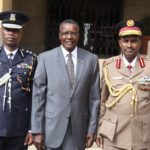 Chief Justice David Maraga (centre) with Deputy Inspectors General Njoroge Mbugua and Noor Gabow