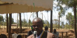 Matete sub county education director Tom Oluoch addressing parents and stakeholders during the of Maturu special school