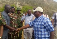 Interior CS Fred Matiang'i is welcomed by former West Pokot Governor and Education CAS Simon Kachapin