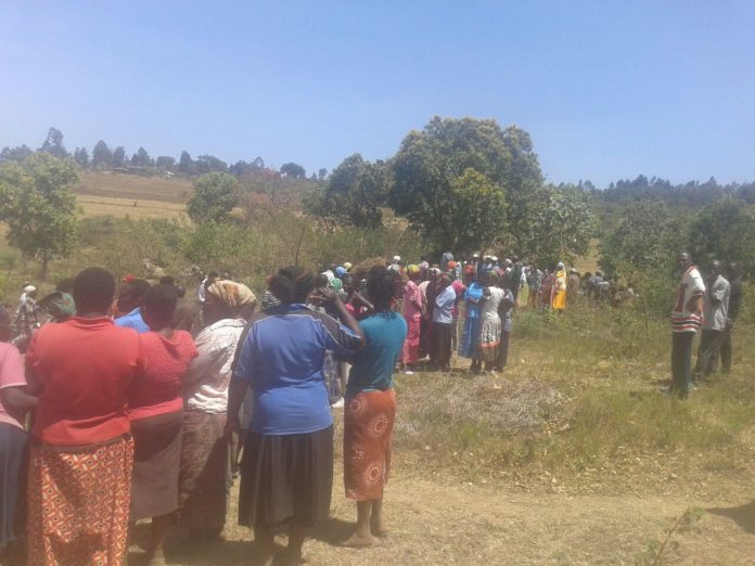 Sango residents at the scene where the body was found