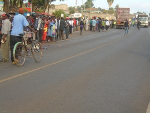 Residents gather at the scene of the accident