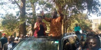 Trans Nzoia Governor Patrick Khaemba waves to his supporters after the victorious verdict