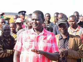 Senator Samuel Poghisio and West Pokot Governor John Lonyangapuo at the scene with residents