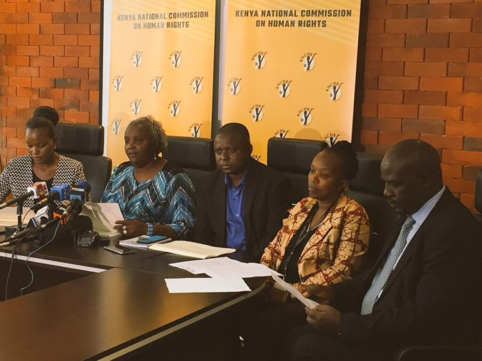 KNCHR boss Kagwiria Mbogori (second left) addressing the press