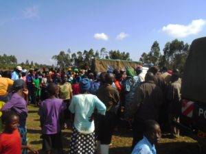 Kewa village residents at the scene where the body of Timothy Kigame was found