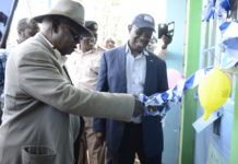 Mr. Peter Nyakiemo, a trustee member at the National Fund for the Disabled of Kenya commissioning the newly constructed classroom for Mentally Challenged children at Ilungu Primary School in Emuhaya