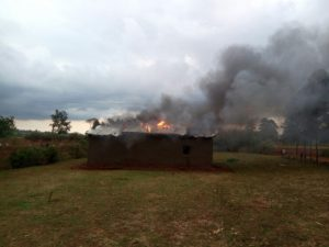 One of the houses torched by the angry mob