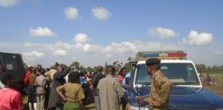 Police officers led by OCPD Benedict Mwangangi when they visited the scene where the body of Timothy Kigame was found