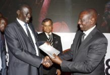 Deputy President William Ruto (right) and Council of Governors Chair Josphat Nanok at the Devolution conference in Kakamega