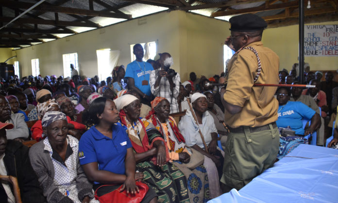 Vihiga County Commissioner John Chelimo talking to the elderly at Edereri Friends in Vihiga Sub County