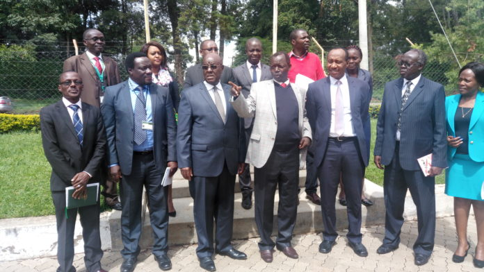 West Pokot Governor John Lonyangapuo together with the JSC team led by Justice Aggrey Muchelule