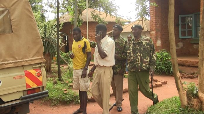 The two sexual abuse suspects, handcuffed, were taken to Kitale Police Station