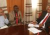 Busia Governor Sospeter Ojaamong, ANPPCAN Director Aggrey Otieno and Program Officer Evans Munga (left) in his office