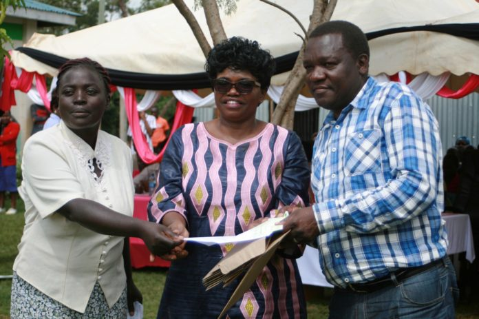Vihiga woman representative Beatrice Adagala (centre) issuing the bursaries