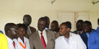 West Pokot Governor John Lonyangapuo (centre) with doctors at Kapenguria Hospital