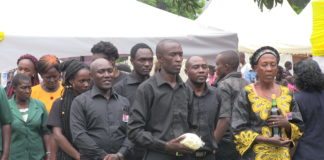 The deceased's family led by the mother Mary Anyango Musundi during the burial service
