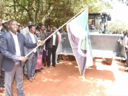 Nandi Governor Stephen Sang flagging off the roadworks equipment